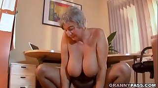 Buxomy Granny Seduces Young Guy With Her Big Tits